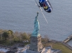 Red Bull Aerobatic Helicopter Pilot, Aaron Fitzgerald, performs flips, barrel rolls and nose dives in front of the Statue of Liberty during the morning hours on May 18th 2019.