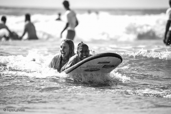 Hayley-Raman-first-time-surfer-with-Caitlyn-Water-as-her-water-assist-sharing-the-joy